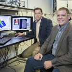 ORNL software engineer Eric Lingerfelt (right) and Stephen Jesse (left) of ORNL's Center for Nanophase Materials Sciences led the development of the Bellerophon Environment for Analysis of Materials (BEAM), an ORNL platform that combines the lab's state-of-the art imaging technologies with advanced data analytics and high-performance computing to accelerate materials science research.